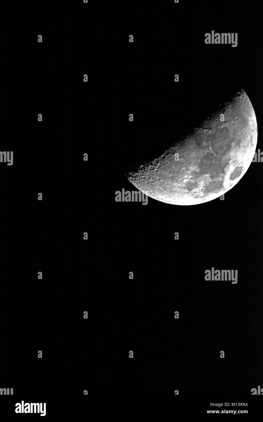 Half moon on winters night - Stock Image