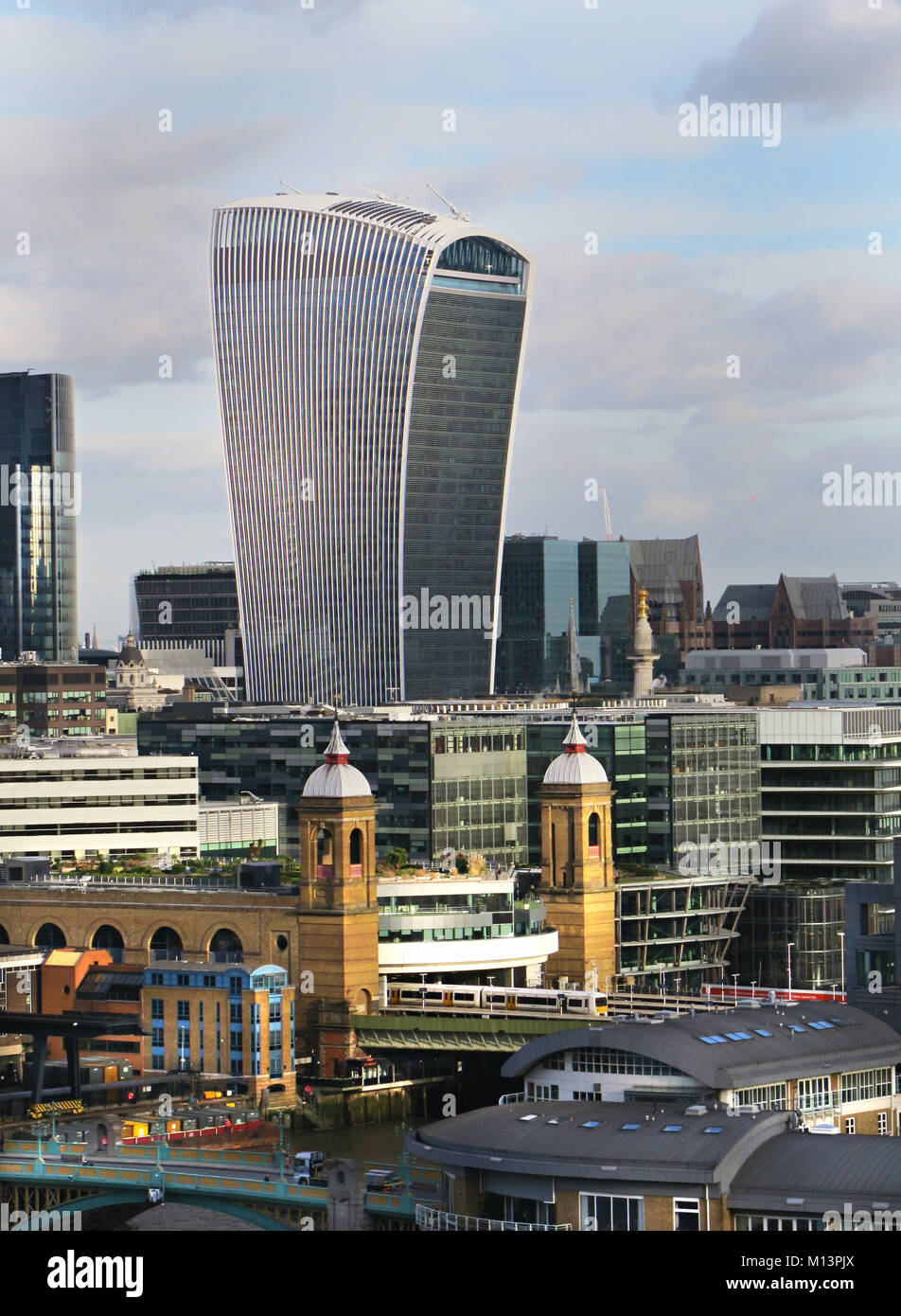 View of the Walkie Talkie and Cannon Street Station in the City of London UK - Stock Image