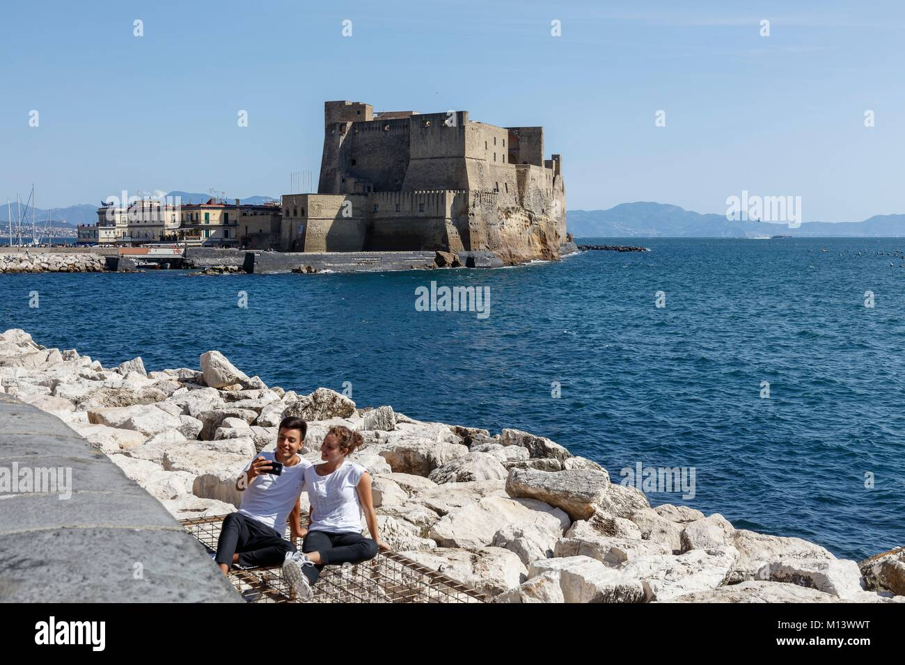 Italy, Campania, Naples, historic centre listed as World Heritage by UNESCO, young couple making a selfie before - Stock Image