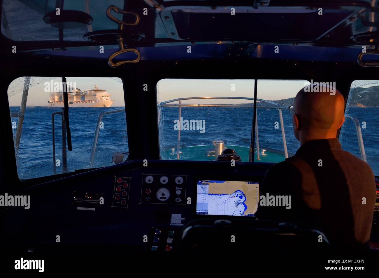 France, Bouches du Rhone, Marseille, the boss of Pilot boat Sylvain joining a cruise ship - Stock Image