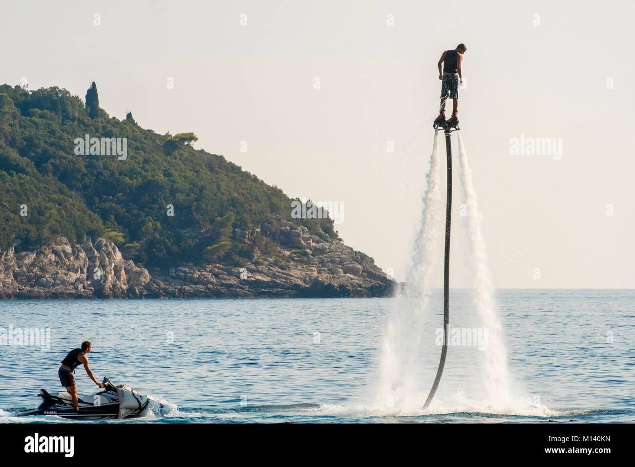 Croatia, Central Dalmatia, Dalmatian coast, Dubrovnik, Flyboard: water jetpack connected to a watercraft (Jet ski) - Stock Image