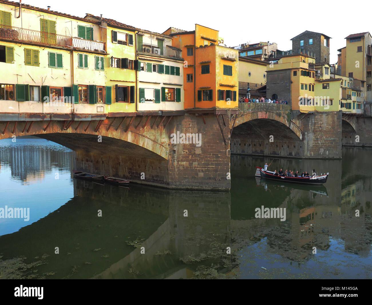 Tourist Gondola in Arno River Ponte vecchioEurope,Italy,Tuscany,Florence, - Stock Image