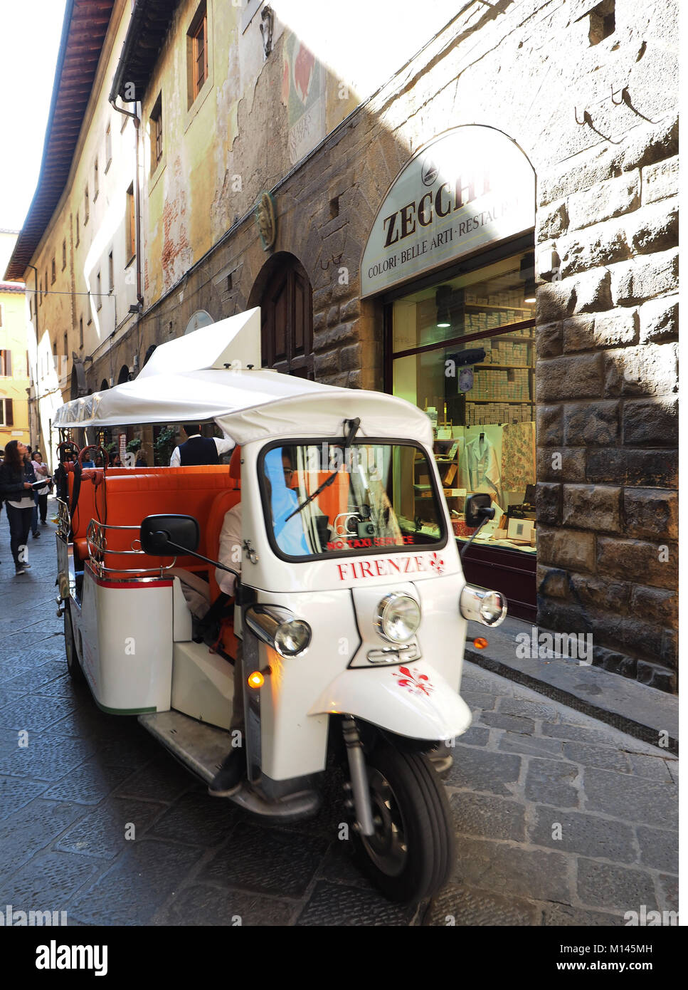 Europe,Italy,Tuscany,Florence,Tourist visit the old town by ape car - Stock Image