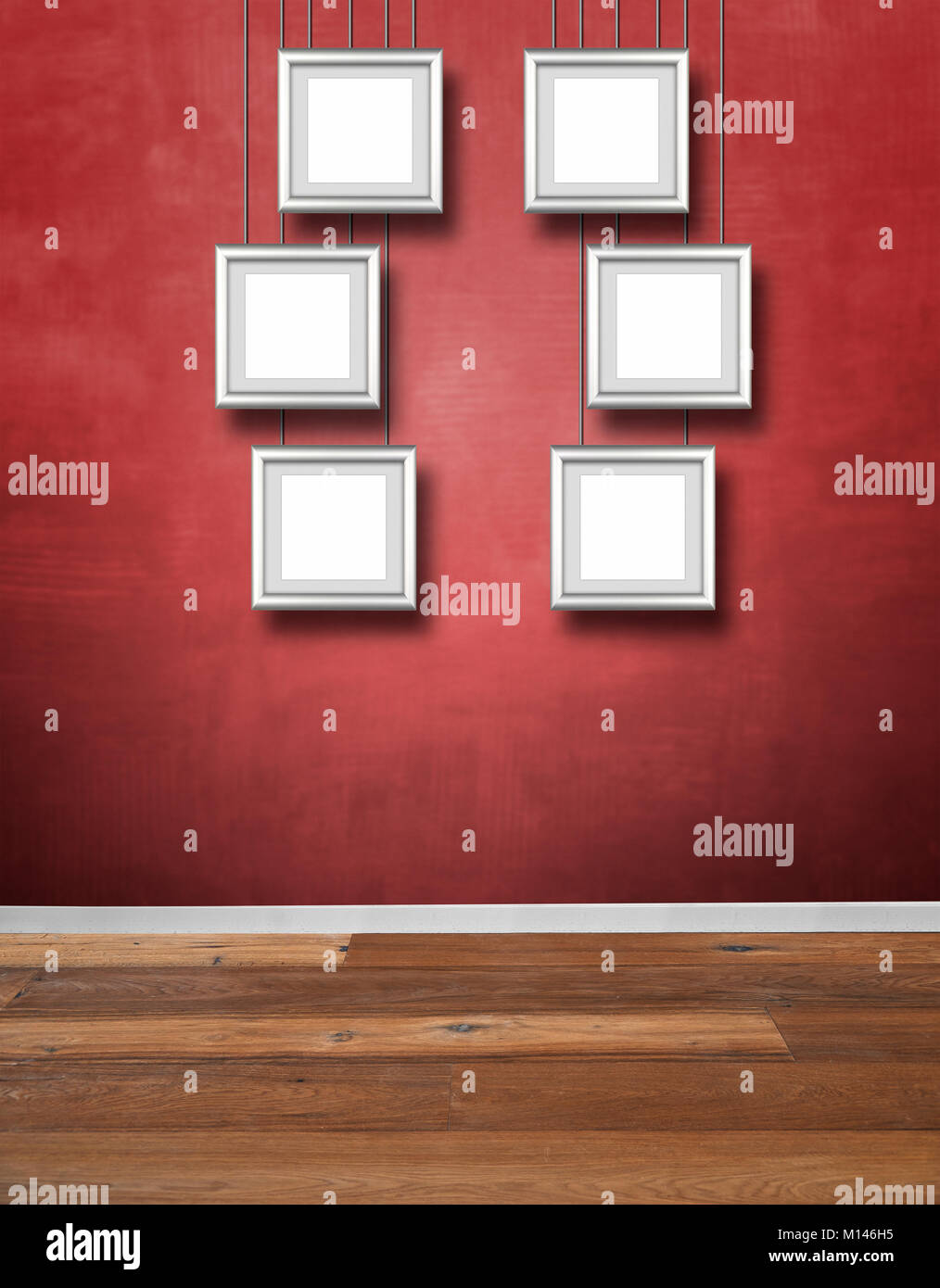 Red textured wall and Alu frames hanging - Stock Image