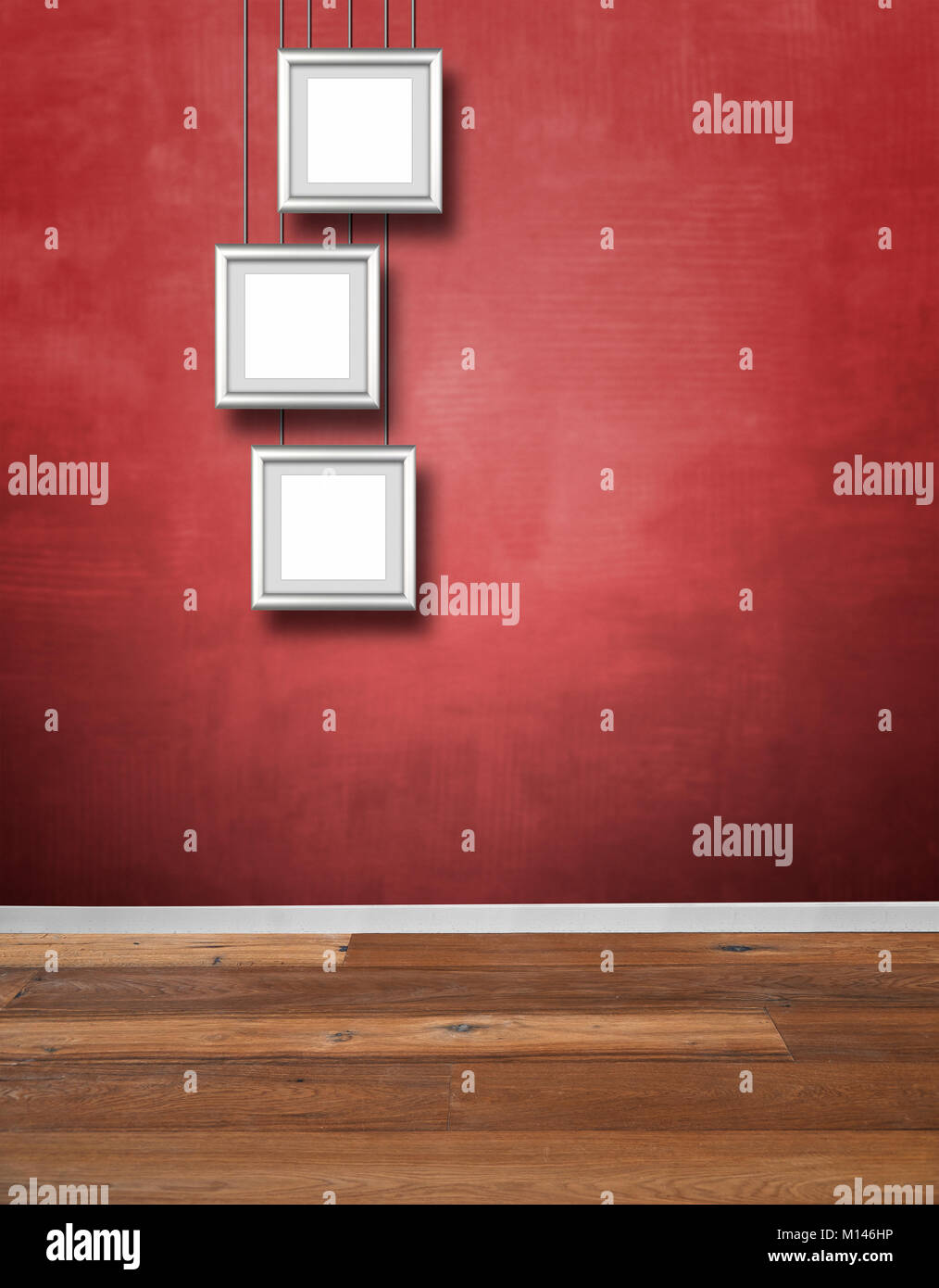 Red textured wall and Alu frames hanging Stock Photo