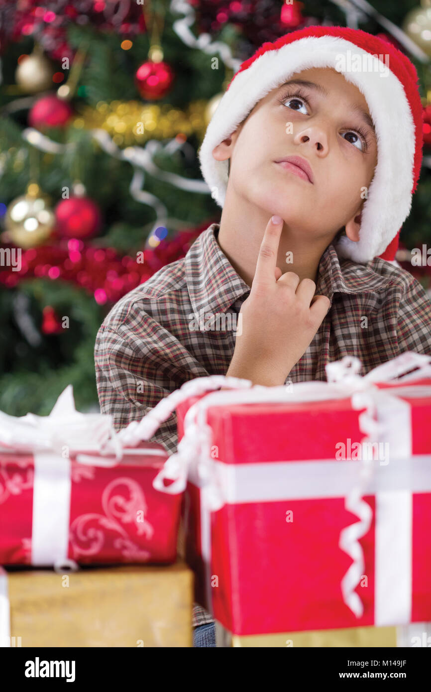 boy imagines what he received from gifts on Christmas night - Stock Image