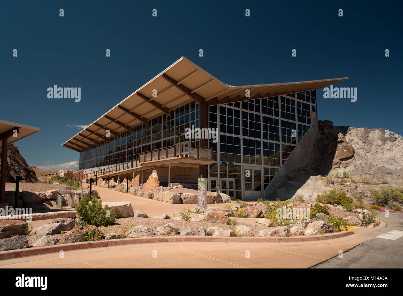 The Quarry Exhibit Center at Dinosaur National Monument, Utah.  The exhibit hall contains a wall of rock yielding - Stock Image