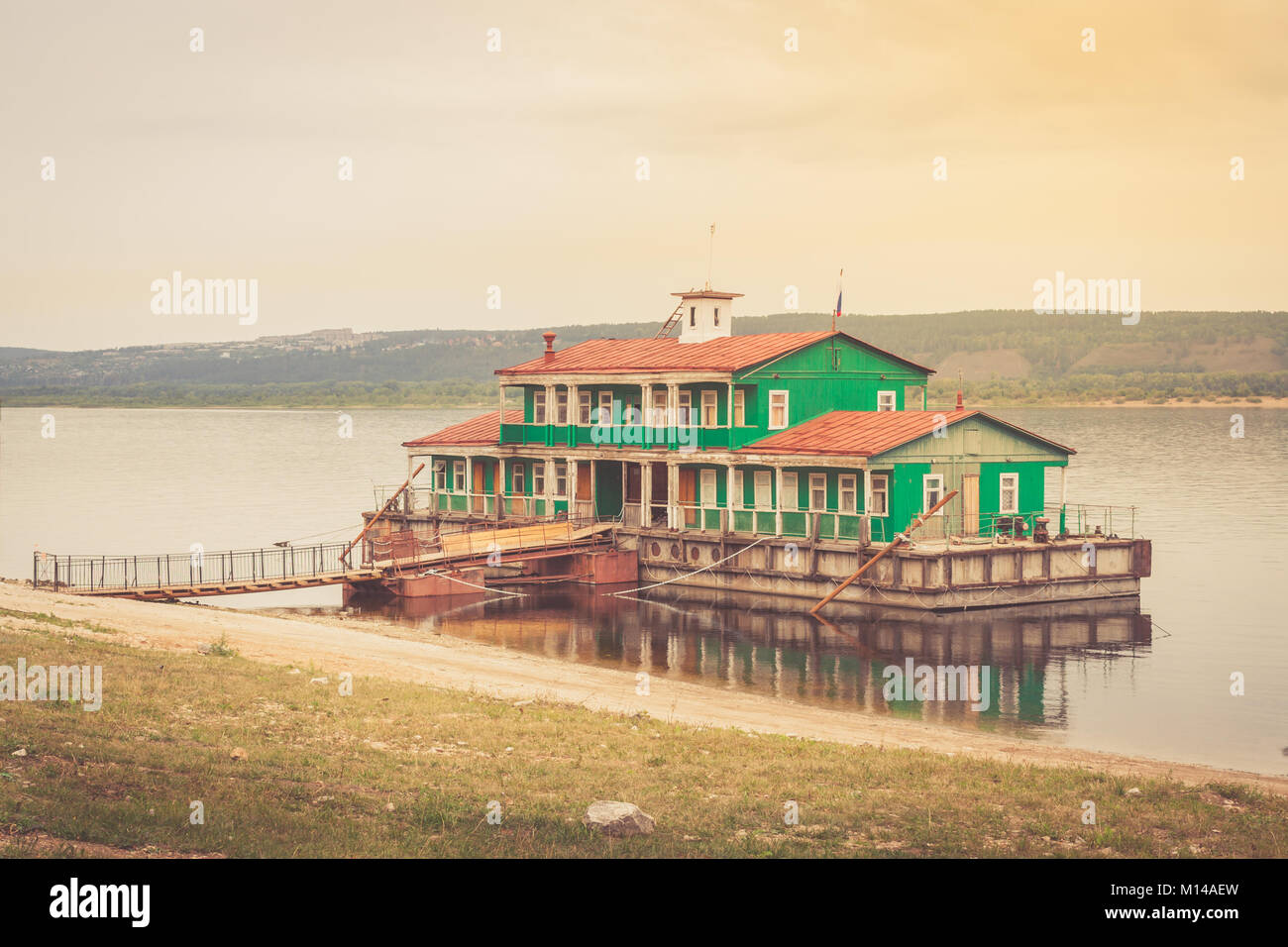 Small wooden mobile floating pier on the Volga river. Toned imag - Stock Image