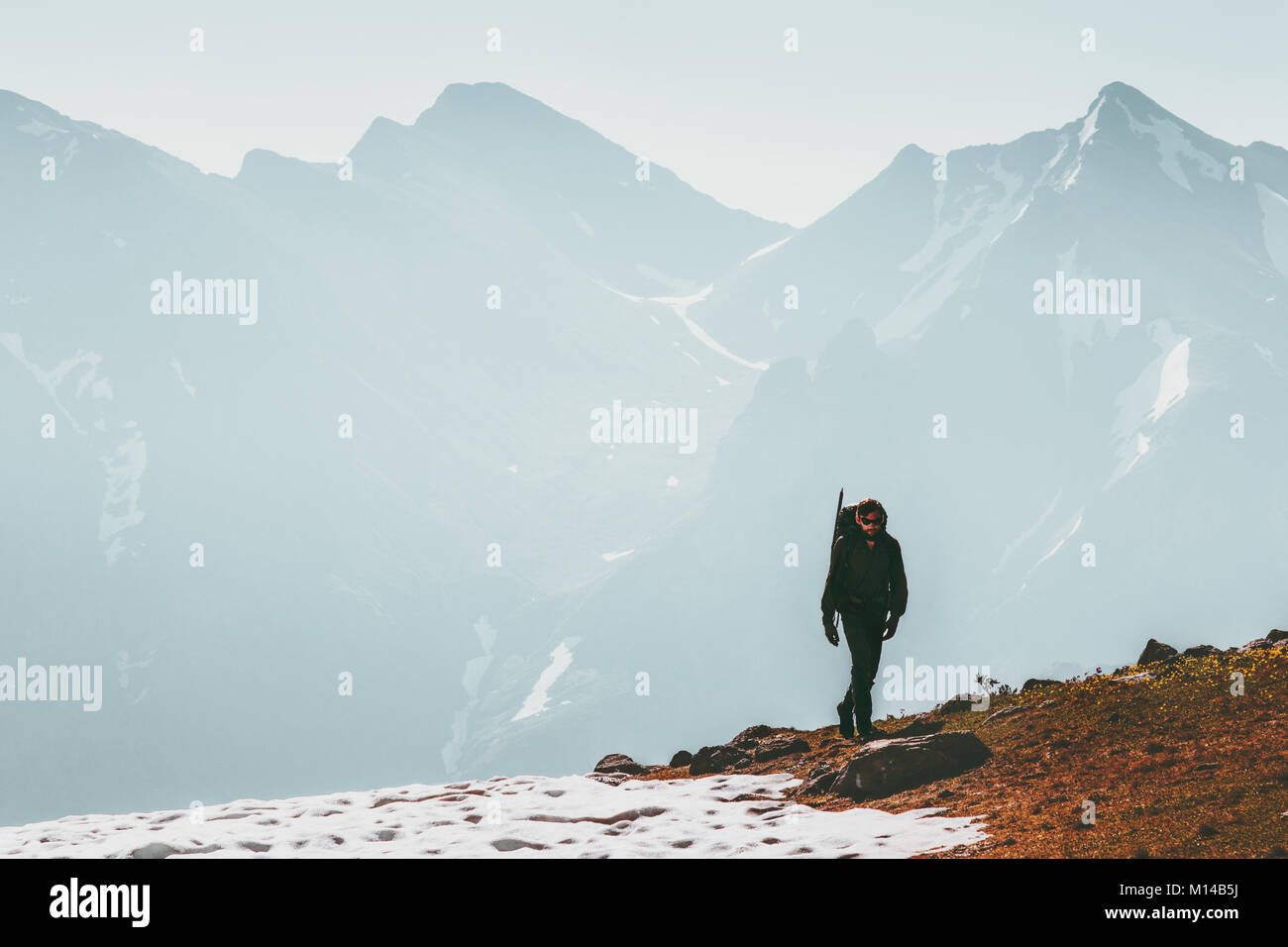 Active Man hiking alone in mountains Lifestyle travel survival concept adventure outdoor active vacations climbing - Stock Image