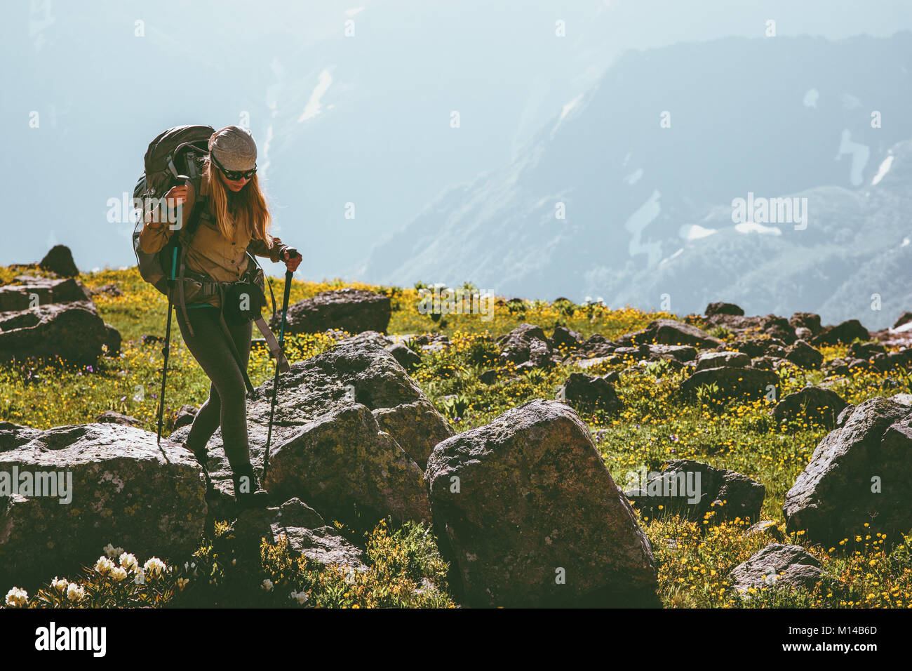 Active vacations in mountains woman hiking with backpack adventure Travel Lifestyle concept outdoor mountaineering - Stock Image