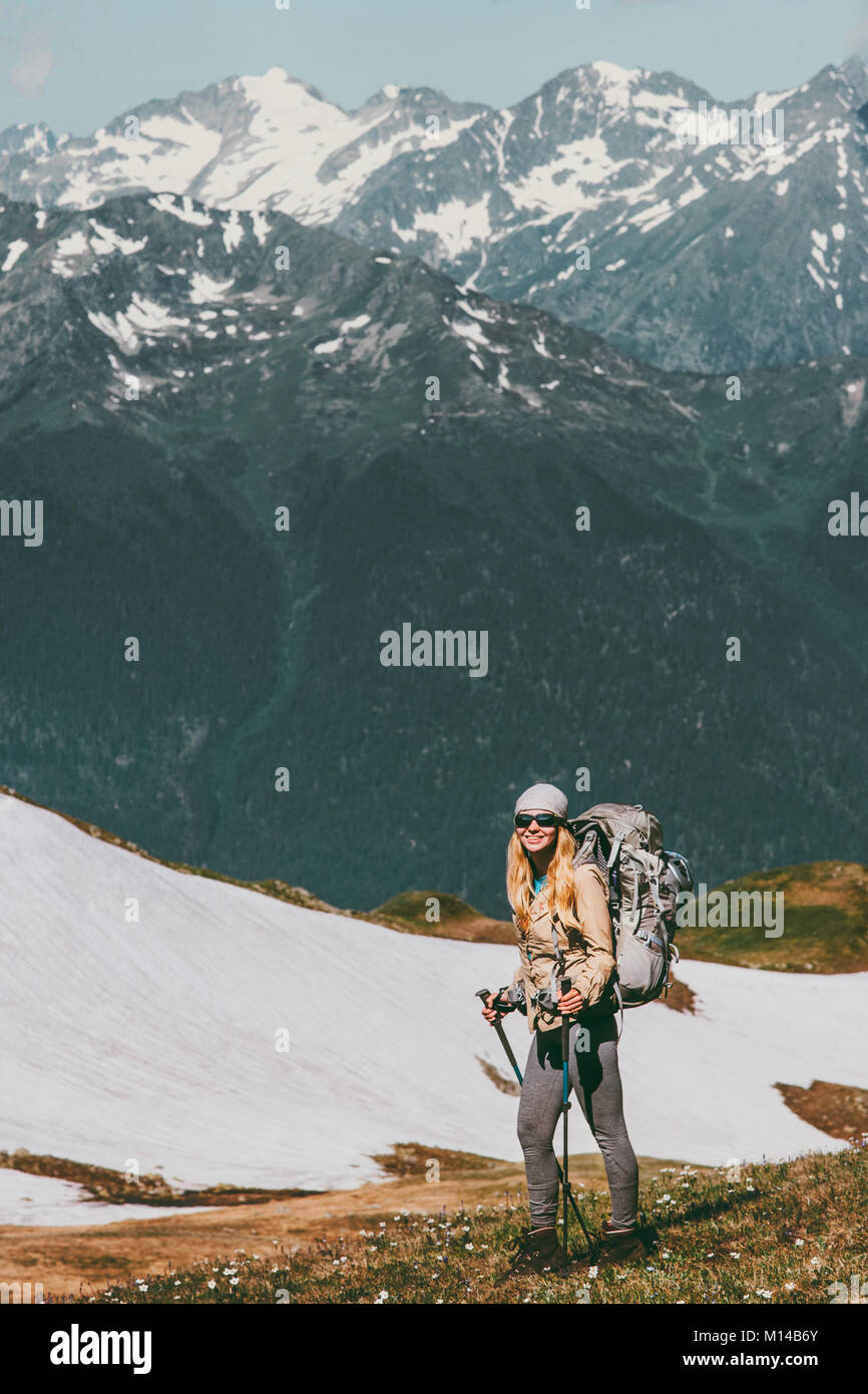 Woman climbing with backpack adventure Travel healthy Lifestyle wanderlust concept outdoor active vacations in mountains - Stock Image