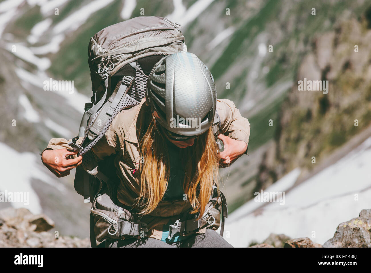 Woman with backpack hiking in mountains Travel healthy lifestyle adventure concept active summer vacations outdoor - Stock Image