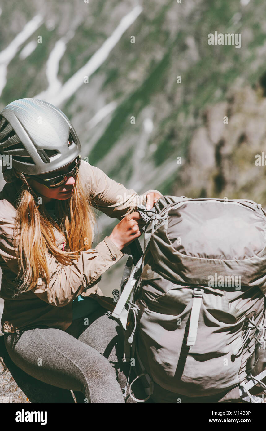 Woman climber with backpack in mountains Travel Lifestyle adventure concept active vacations outdoor gear sport - Stock Image