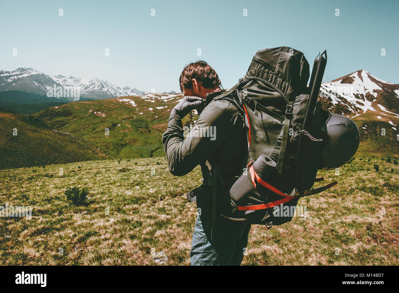 Travel Man with big backpack  mountaineering Lifestyle survival concept adventure outdoor active summer vacations - Stock Image