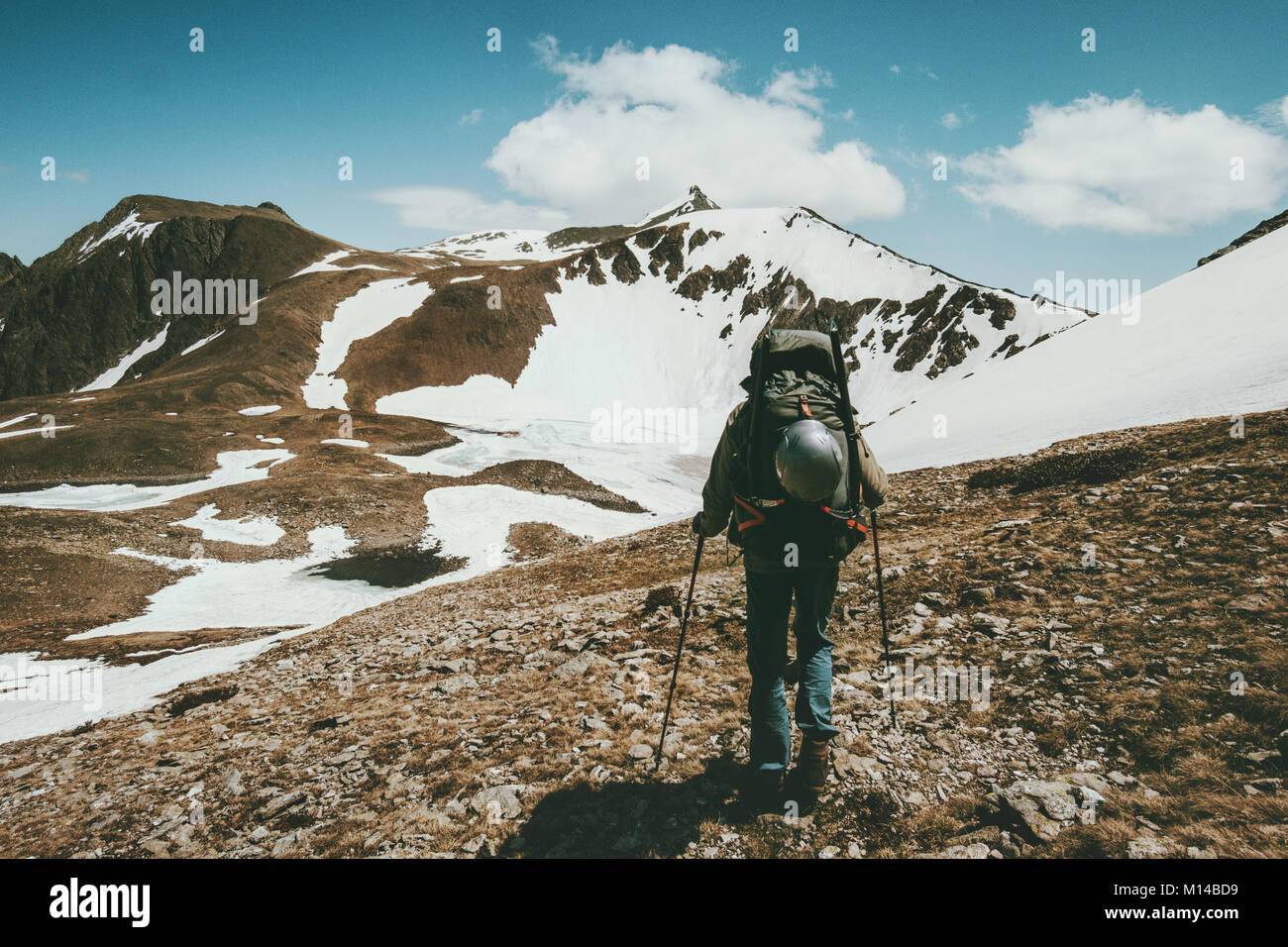 Man hiking with big backpack traveling Lifestyle survival concept adventure outdoor active vacations climbing sport - Stock Image