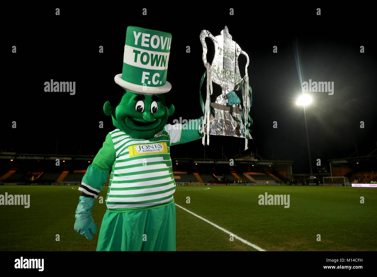 Yeovil Town mascot the Jolly Green Giant on the pitch before the Emirates FA Cup, fourth round match at Huish Park, - Stock Image