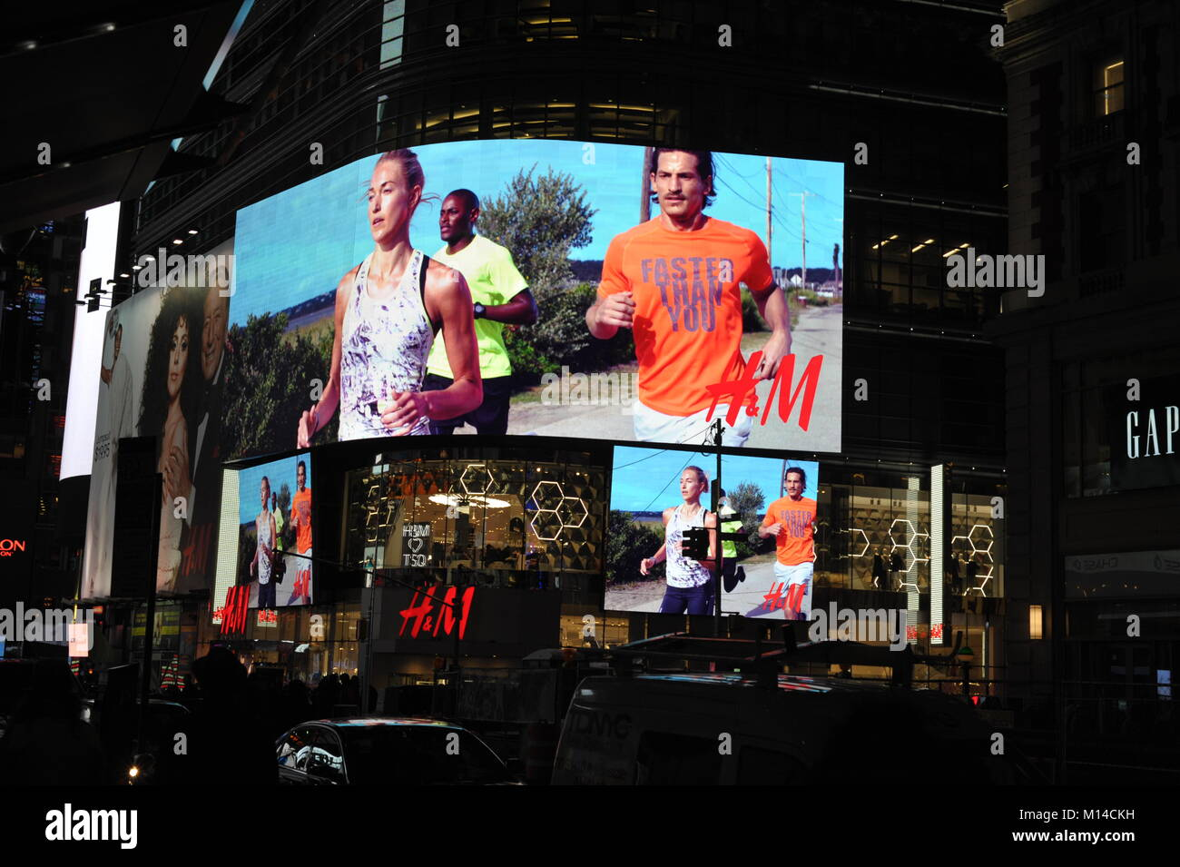 shiny media facade advertizing H&M on 5th avenue in New York City - Stock Image