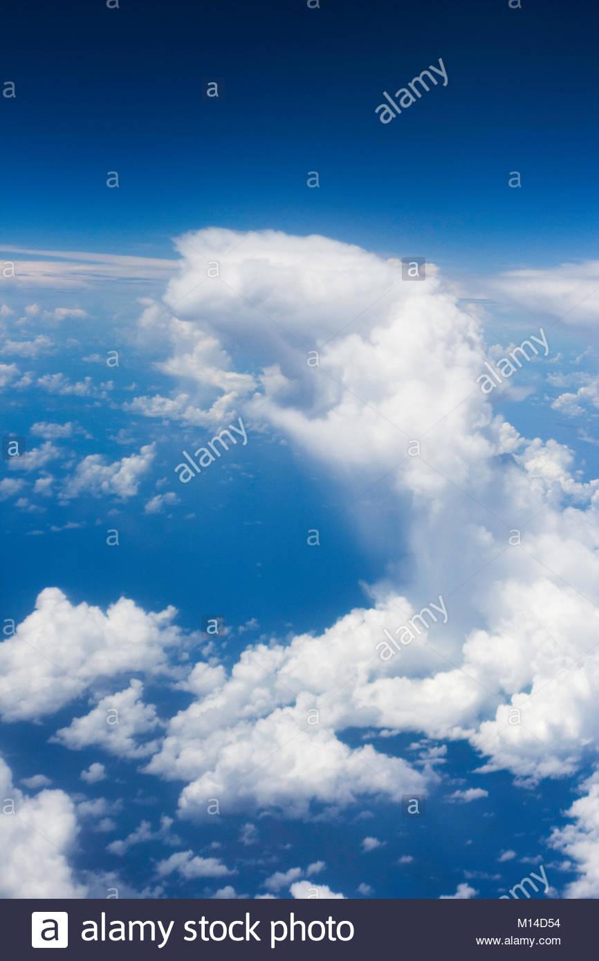 Clouds in the sky during the fly from Nadi (Fiji Islands) to Tarawa (Kiribati) Stock Photo