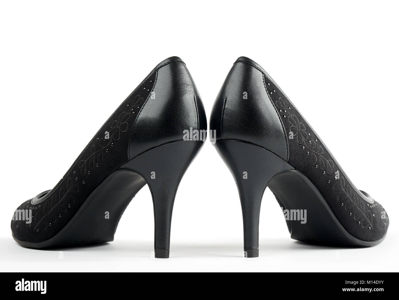 8e31b07d3e Pair of black new women's high-heeled shoes isolated on white - Stock Image