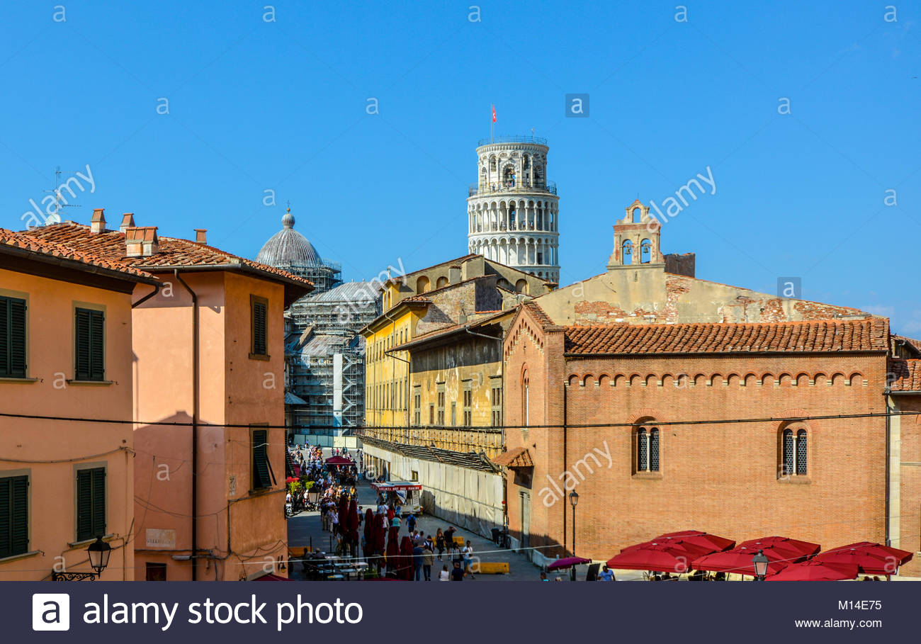 A view from the Grand Hotel Duomo in Pisa Italy on a summer day with the Leaning Tower, Cathedral and tourists in - Stock Image