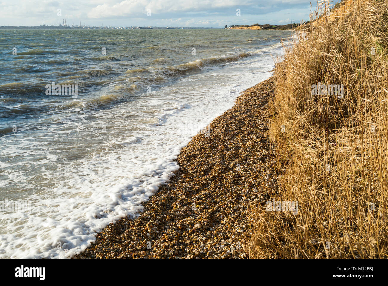 High tide at the shingle beach at Meon Shore on the Solent at Titchfield, Hampshire, UK - Stock Image