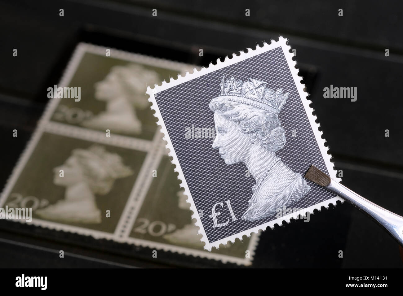 Old one-pound stamp dating from the 1970s. - Stock Image