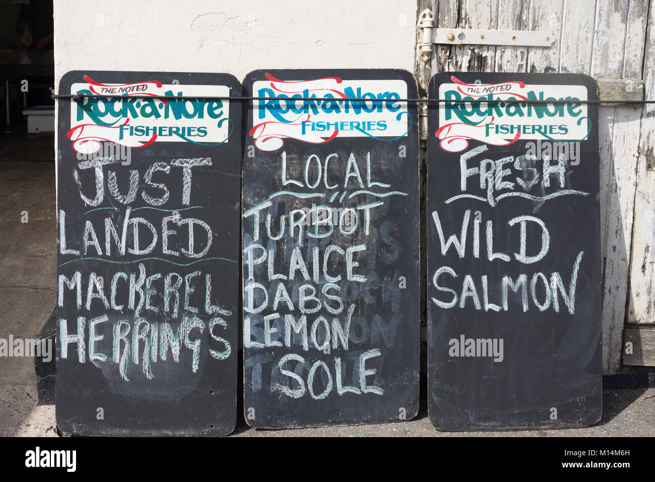 Rock-a -Nore Fisheries fish availabity boards, Hastings Old Town, Rock-a-Nore Road, Hastings, East Sussex, England, - Stock Image