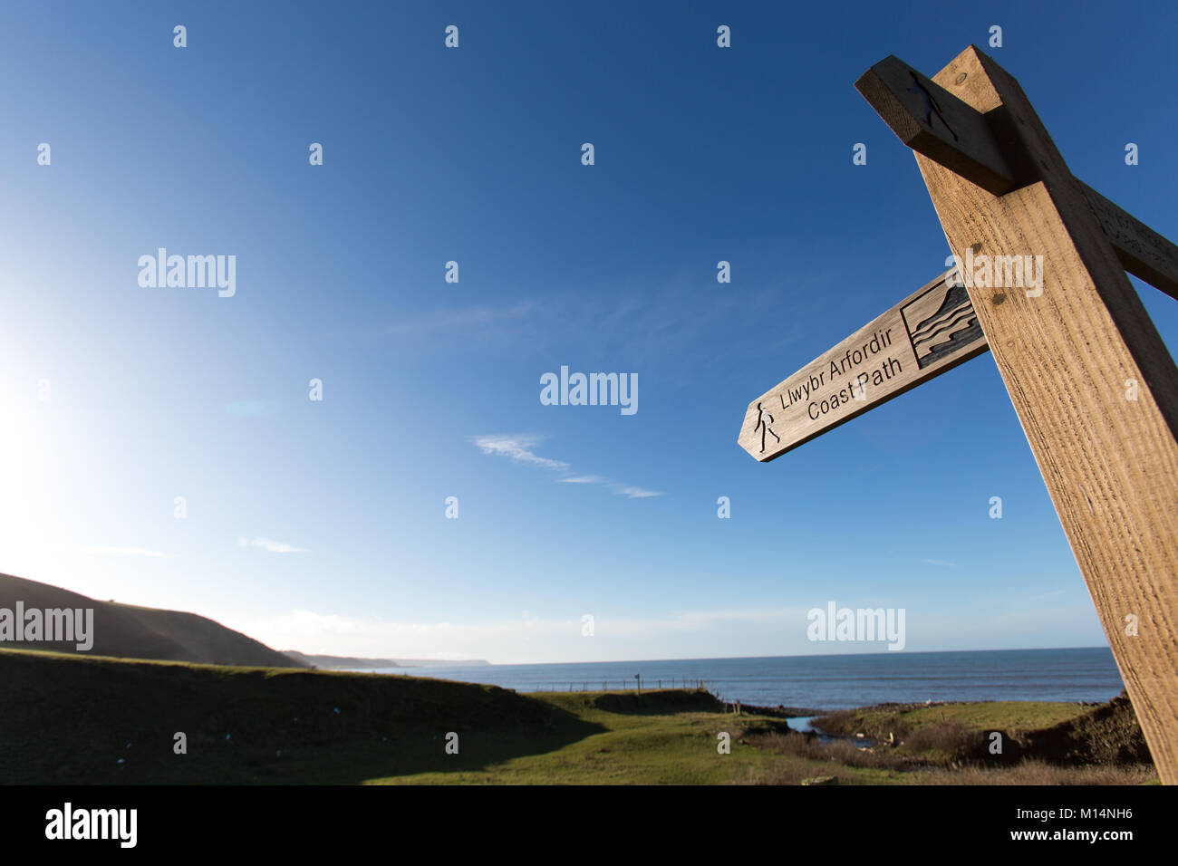 The Wales and Ceredigion Coast Path. A Wales and Ceredigion Coast Path route sign, located between the villages - Stock Image
