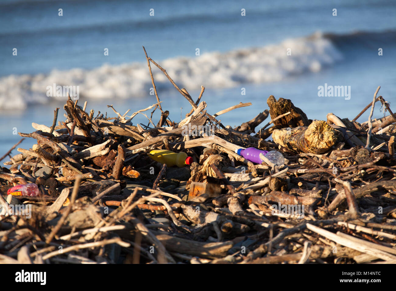 The Wales and Ceredigion Coast Path. Plastic debris washed ashore on a Wales and Ceredigion Coast Path beach. - Stock Image