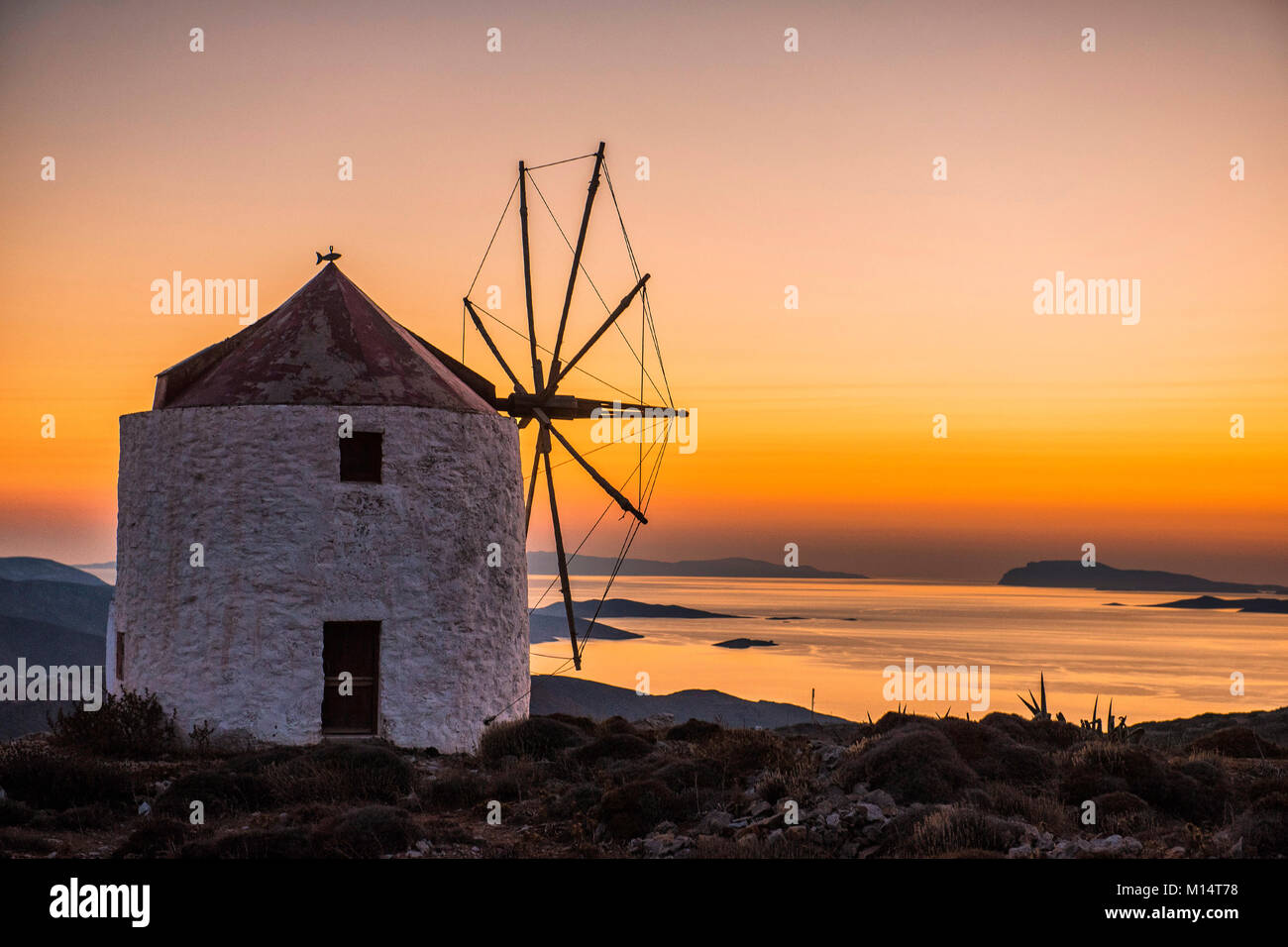 Amorgos, Chora of Amorgos. Cyclades Island, Greece. A windmill on the highest hill of the island with the intense - Stock Image