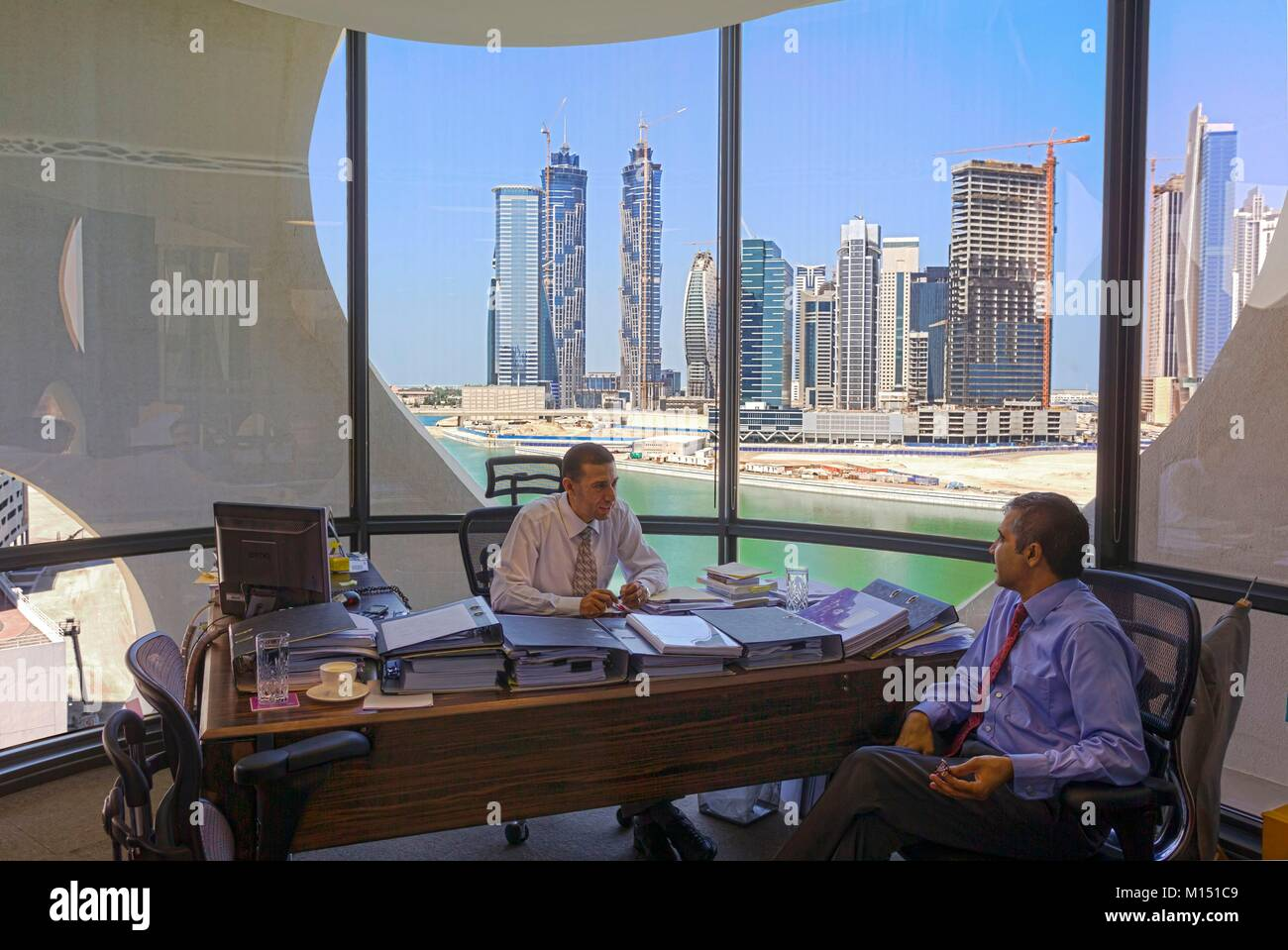 United Arab Emirates, Dubai, offices in 0-14 tower, the swiss tower, at Business Bay - Stock Image