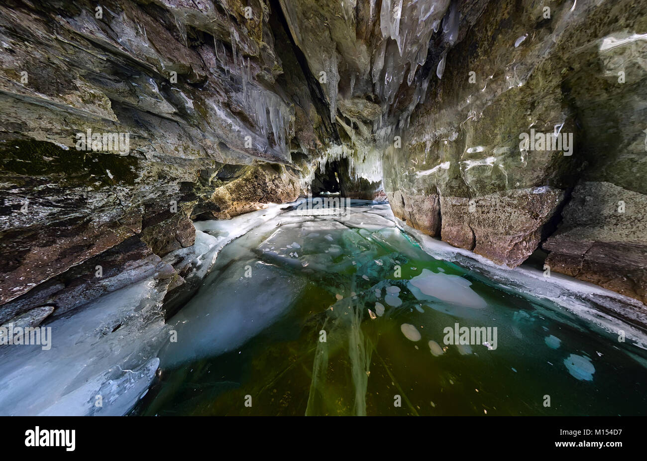 Panorama inside ice cave with icicles on Baikal, Olkhon. - Stock Image