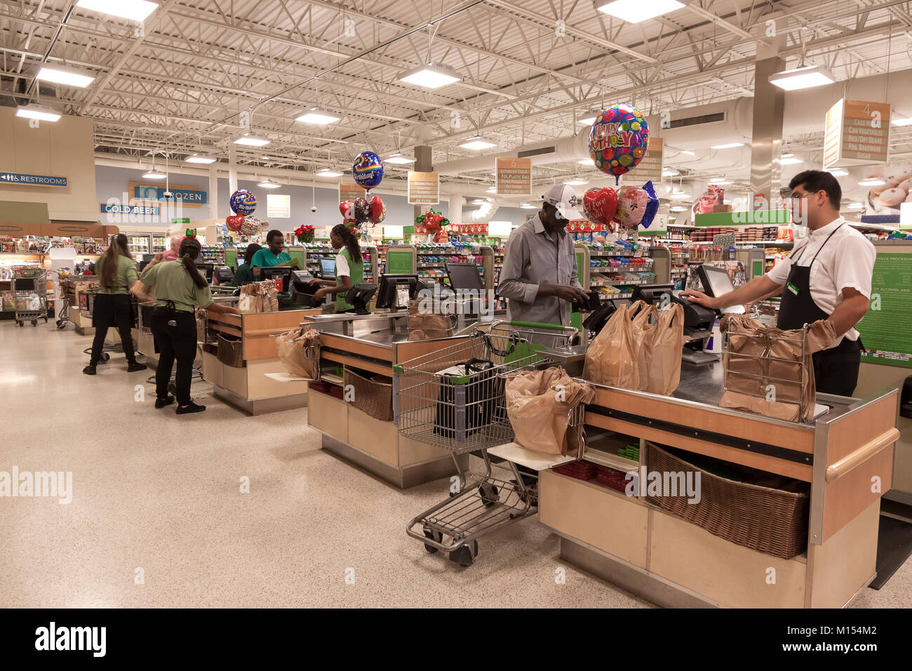 Publix Supermarket checkout counters servicing shoppers in Florida, United States. - Stock Image