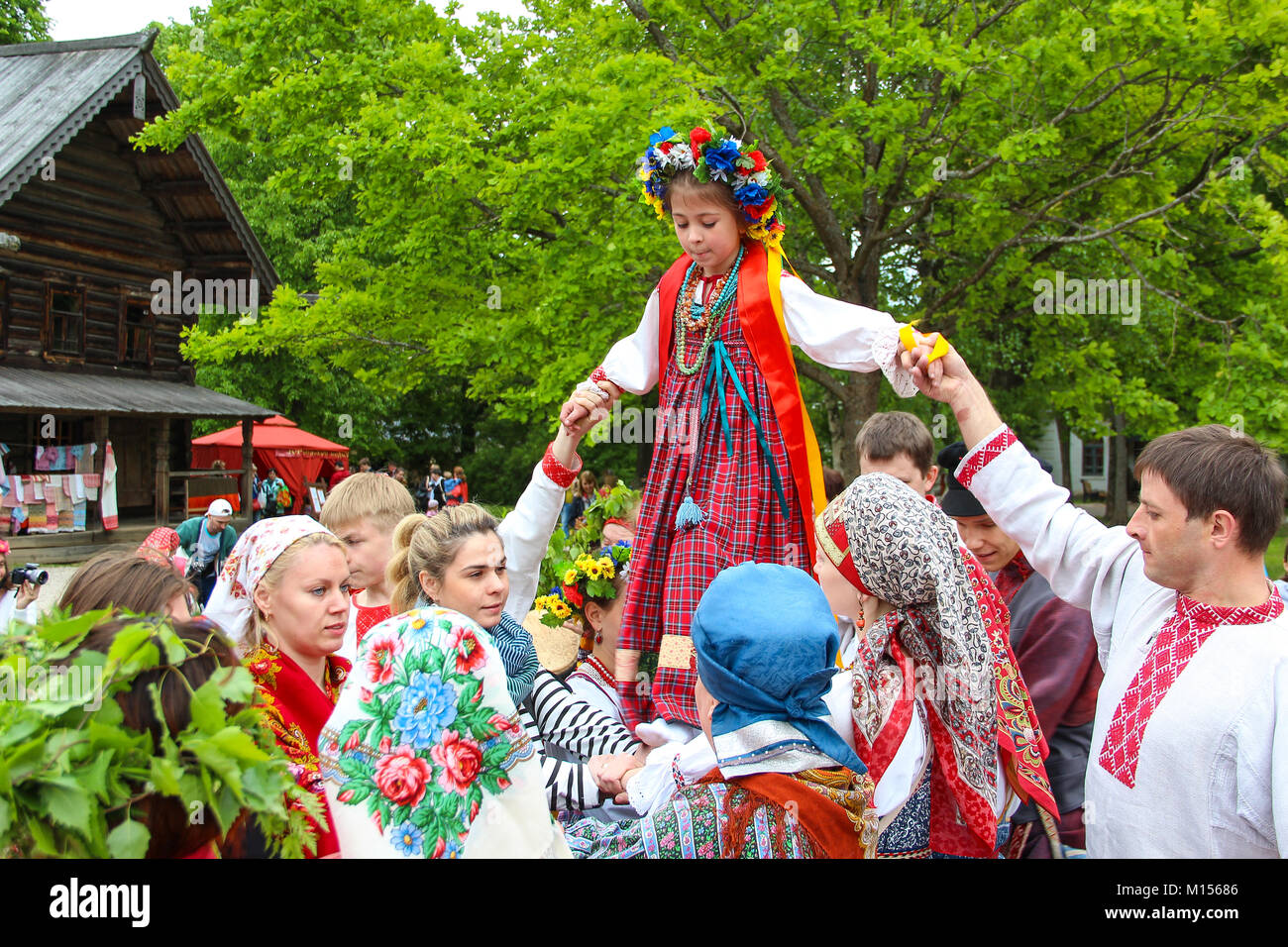 Reconstruction of the ancient Slavic pagan rites 'spike' / 'walking spikelets.' Girls and women - Stock Image
