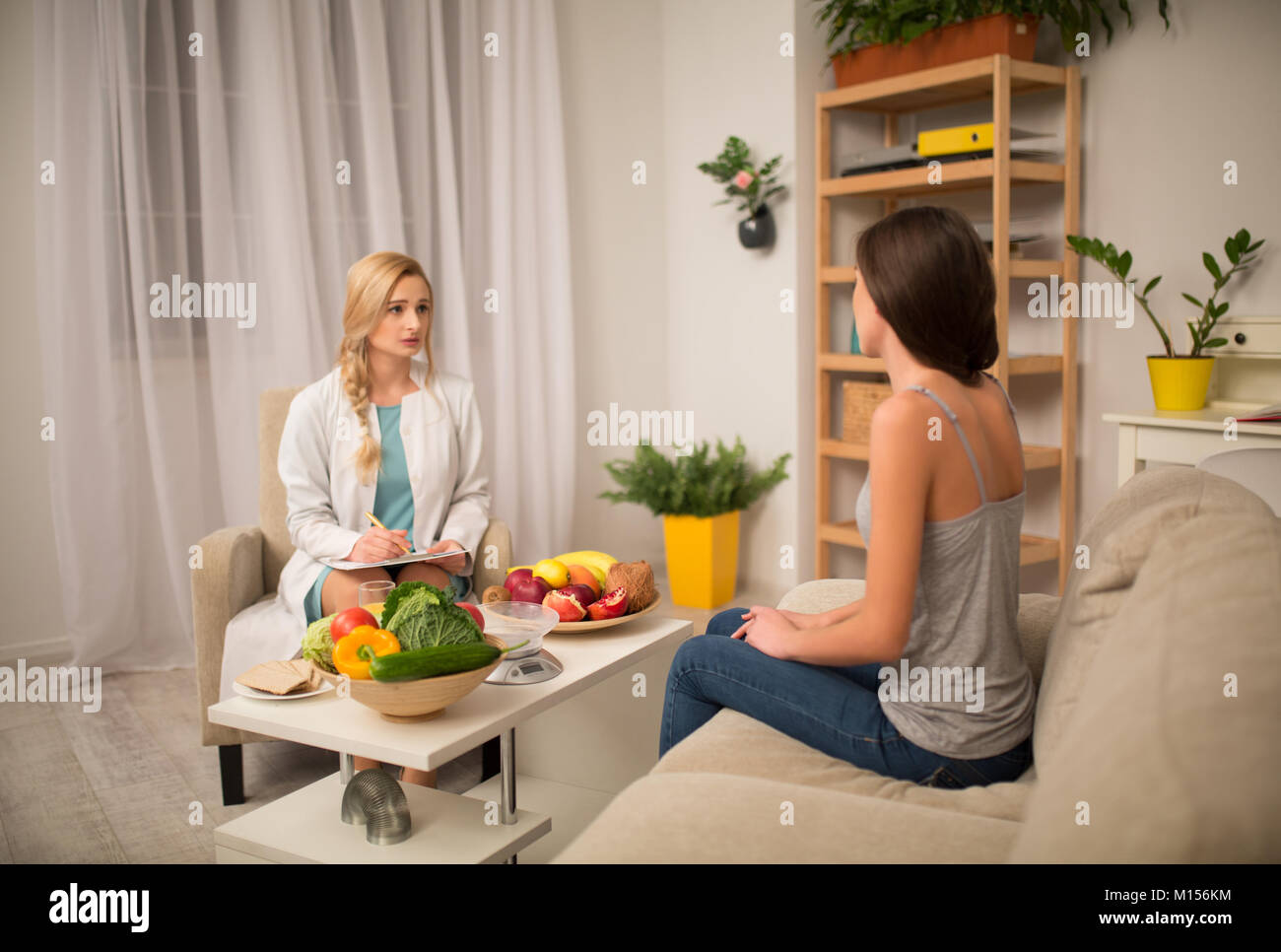 a beautiful nutritionist consult at the office