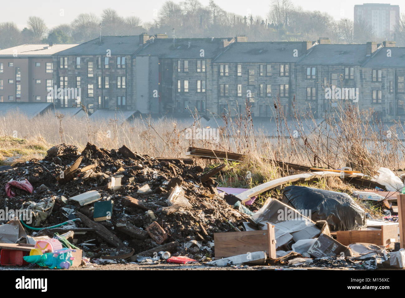 rubbish dumped on vacant derelict land on the edge of Cowlairs Park, Sighthill, North Glasgow, Scotland, UK - Stock Image