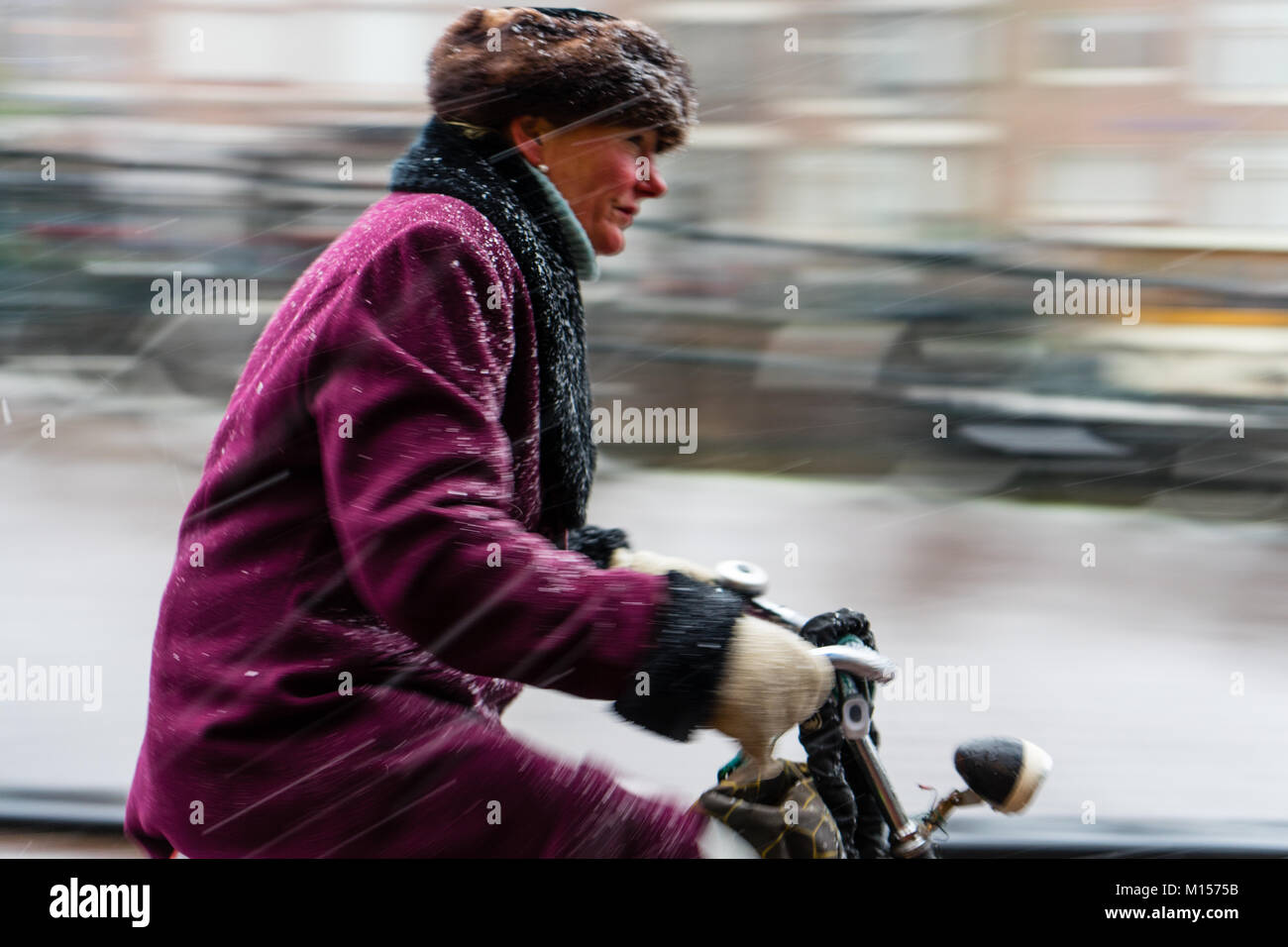 Snowing in Amsterdam - Stock Image