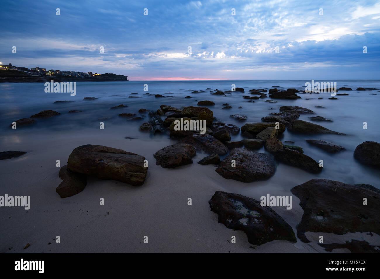 Cloudy sunrise at Bronte beach - Stock Image