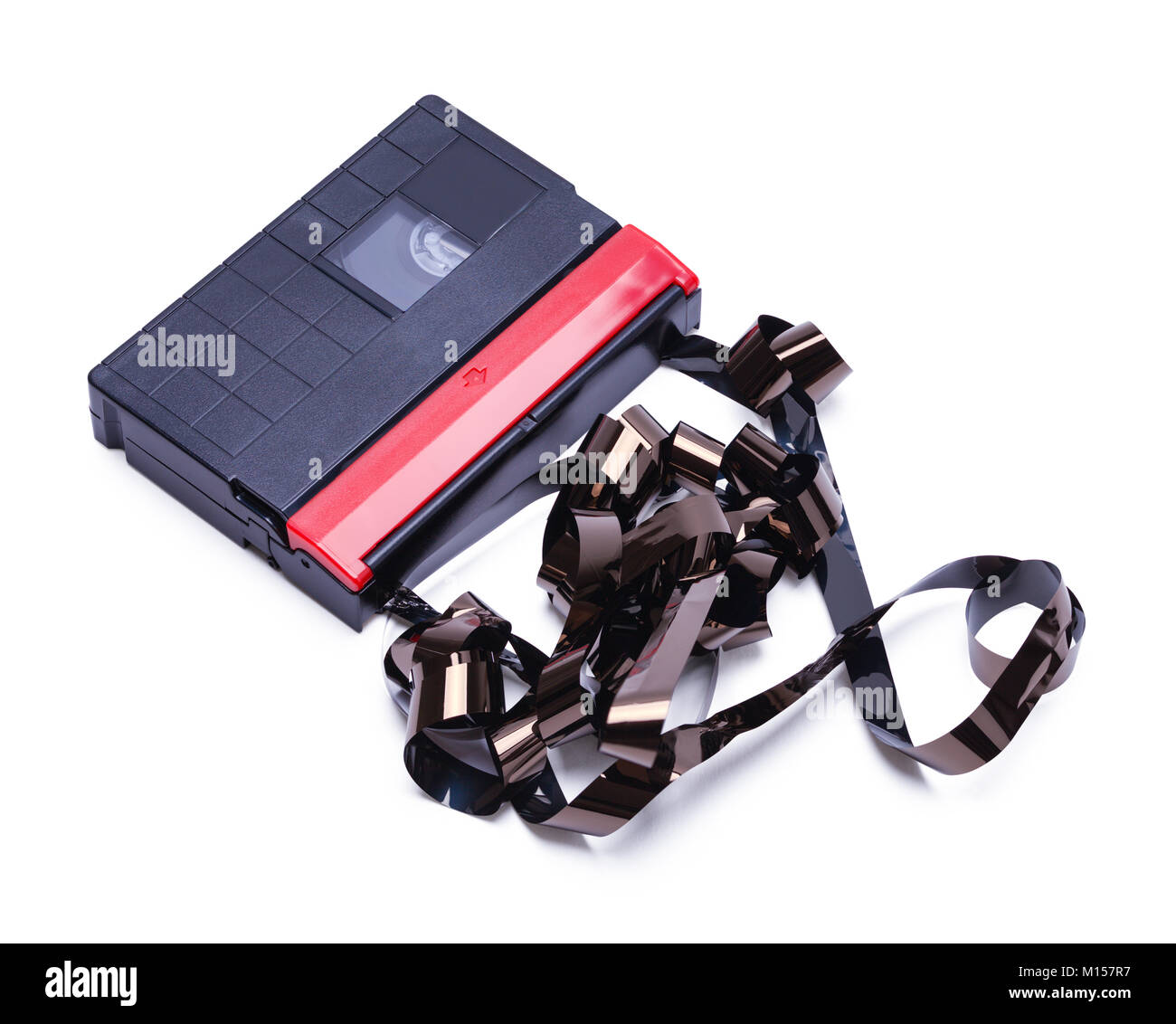 Video Cassette Tape for Home Movie Camera Unwound and  Broken Isolated on a White Background. Stock Photo