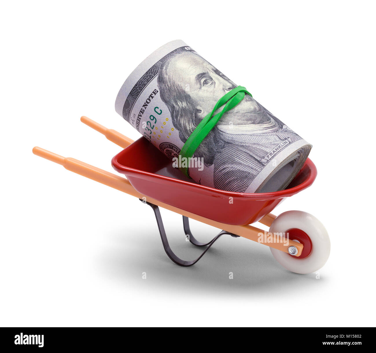 Red Wheel Barrow With a Roll of Hundred Dollar Bills. - Stock Image