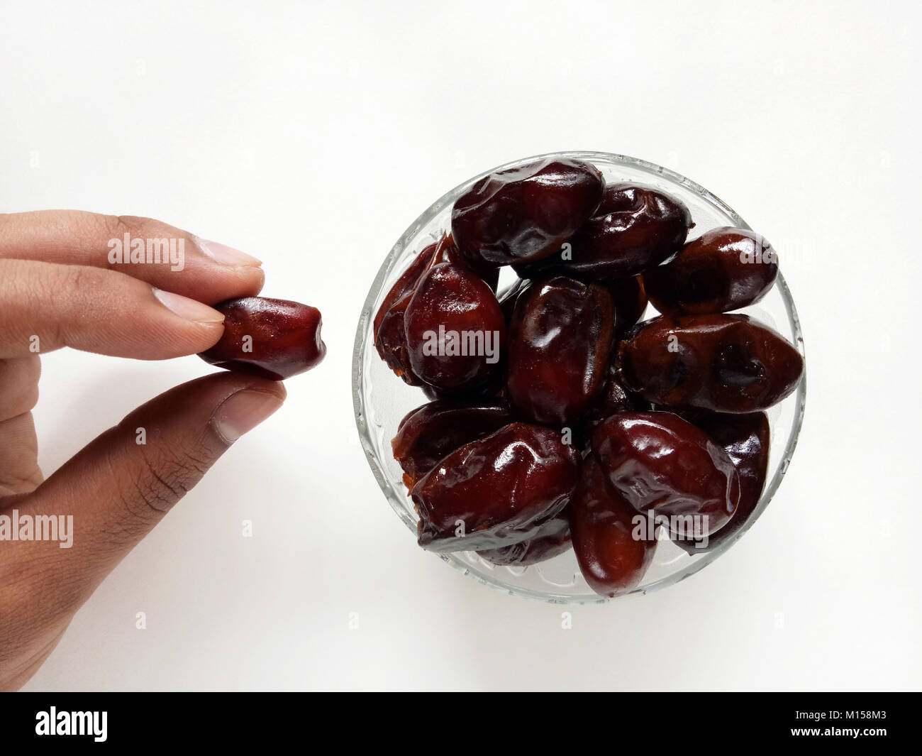 Hand Picked up a Date Fruit - Stock Image