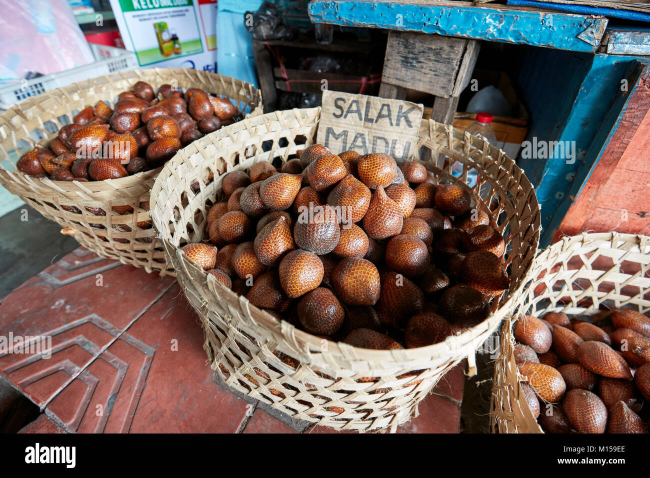 Baskets full of Salak, or Snake Fruit (Scientific name: Salacca zalacca) for sale on Malioboro street. Yogyakarta, - Stock Image