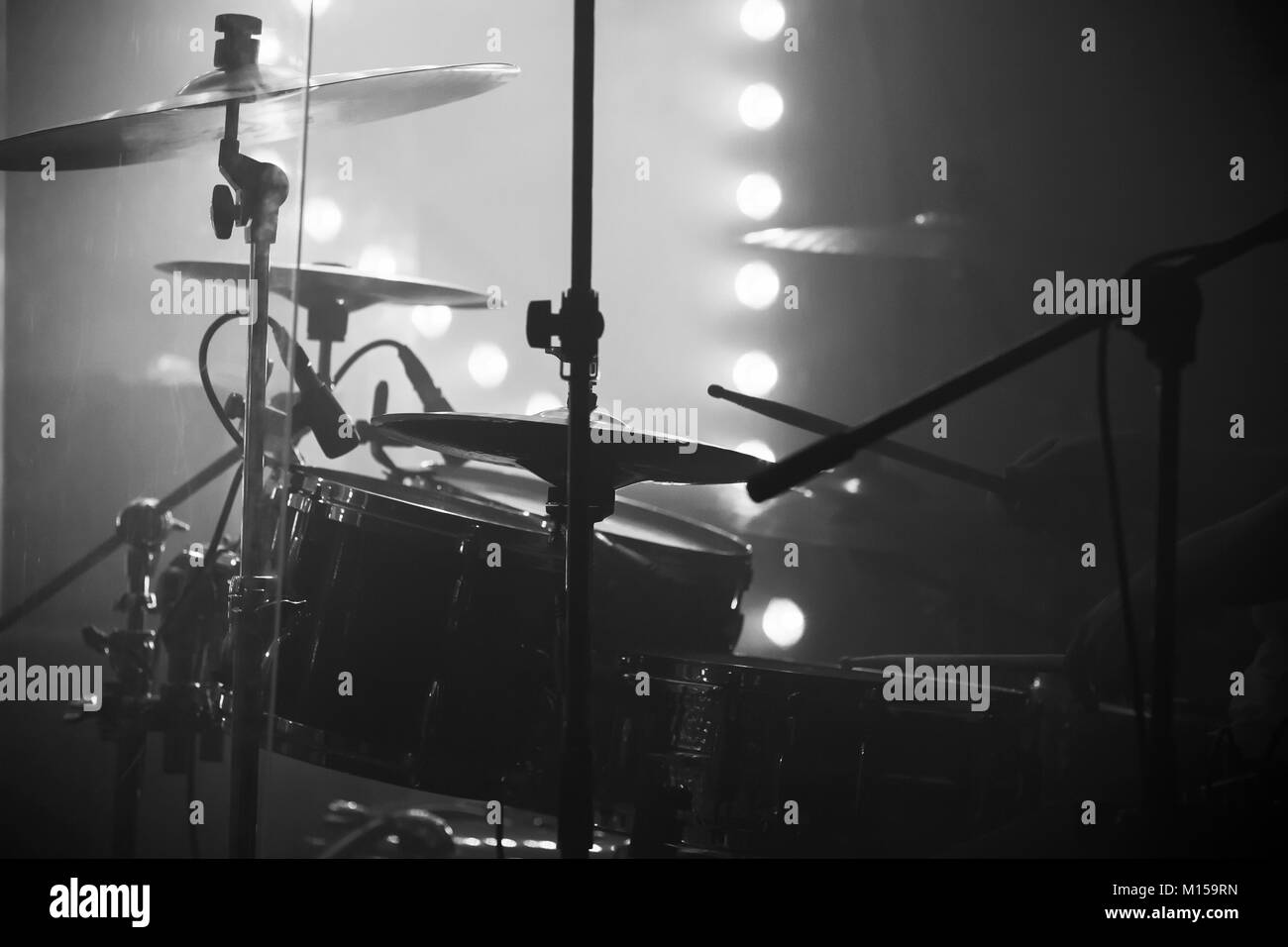 Live Music Photo Drum Set With Cymbals And Stage Lights On A Stock
