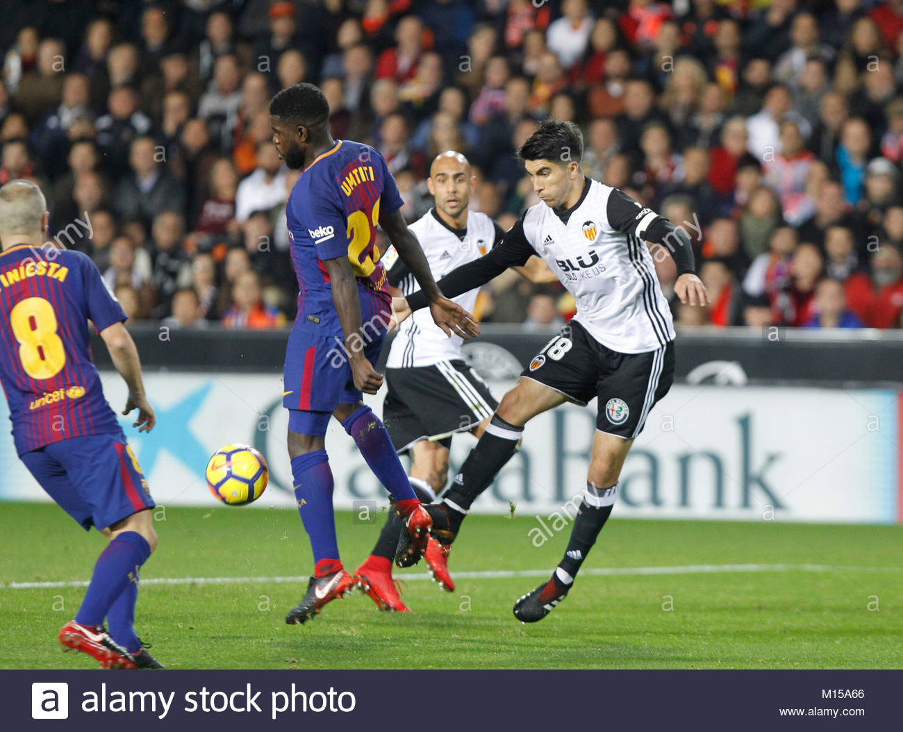 Carlos Soler of valencia and Umtiti of barcelona during a match in Mestalla stadium in valencia, Spain Stock Photo