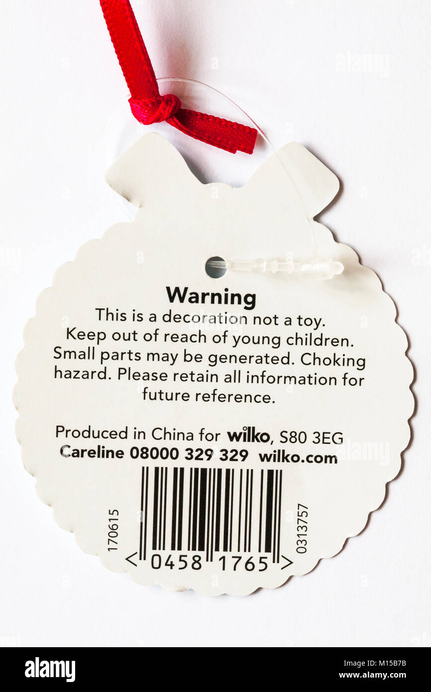 Warning label on Christmas decoration this is a decoration not a toy, keep out of reach of young children, small - Stock Image