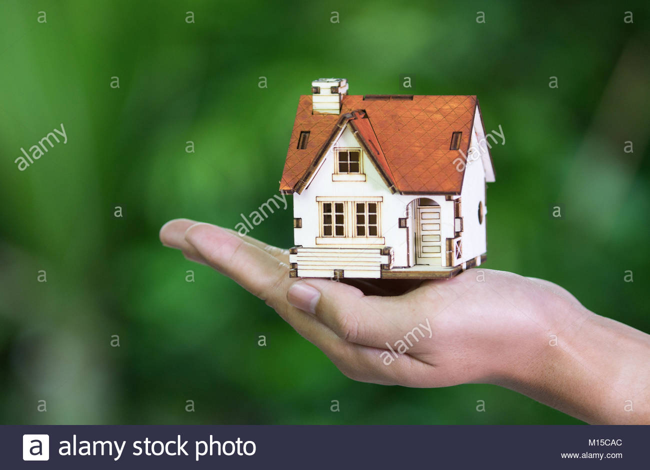 hands holding house. Real estate and property concept. - Stock Image