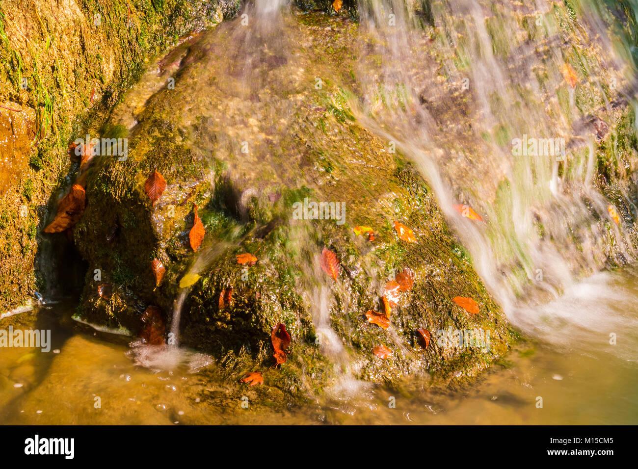The cascade waterfall of the mountain river Bezumenka closeup in sunny autumn day, Sochi, Russia - Stock Image