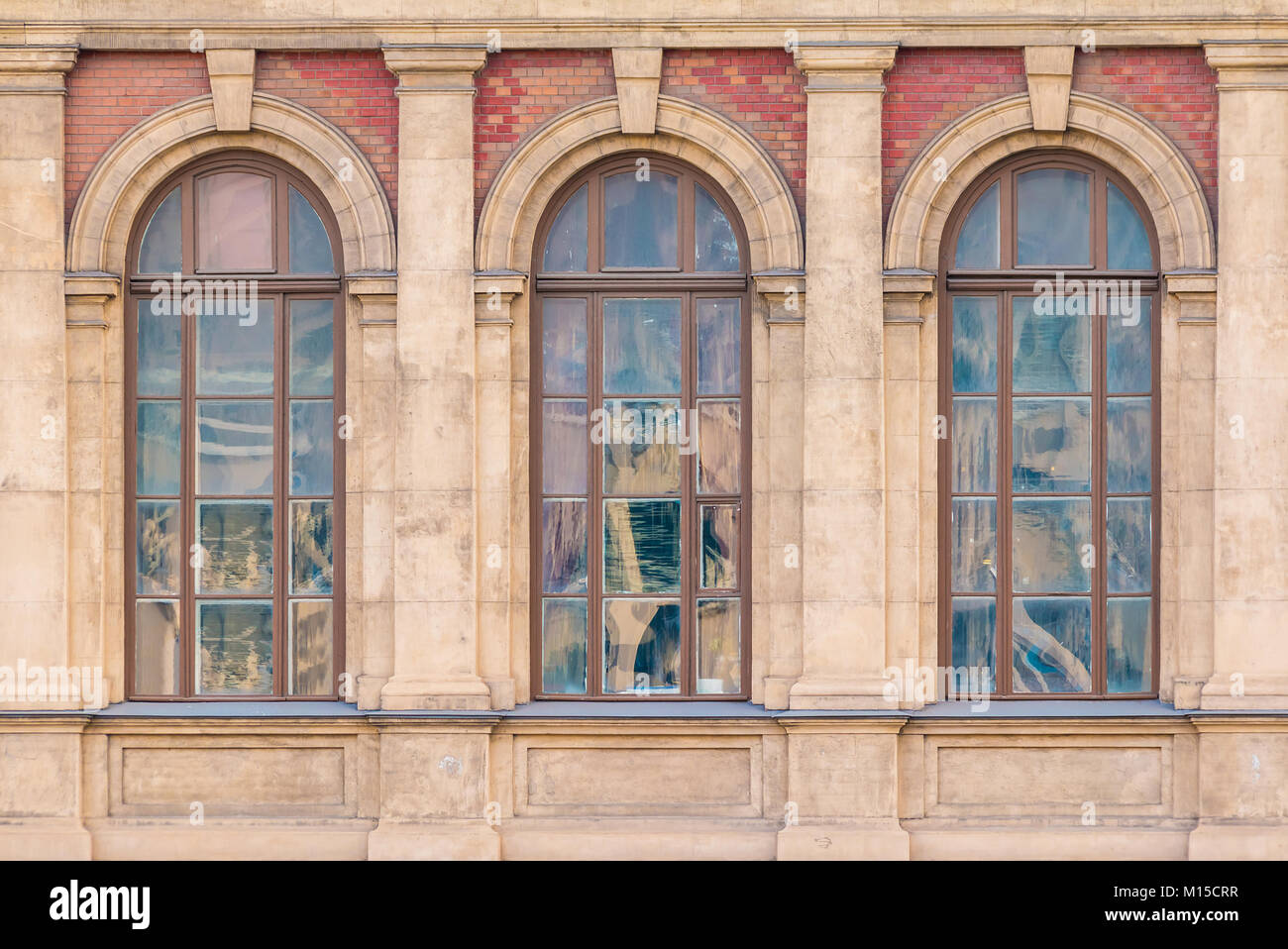 Three windows in a row on the facade of the urban historic building front view, Saint Petersburg, Russia - Stock Image