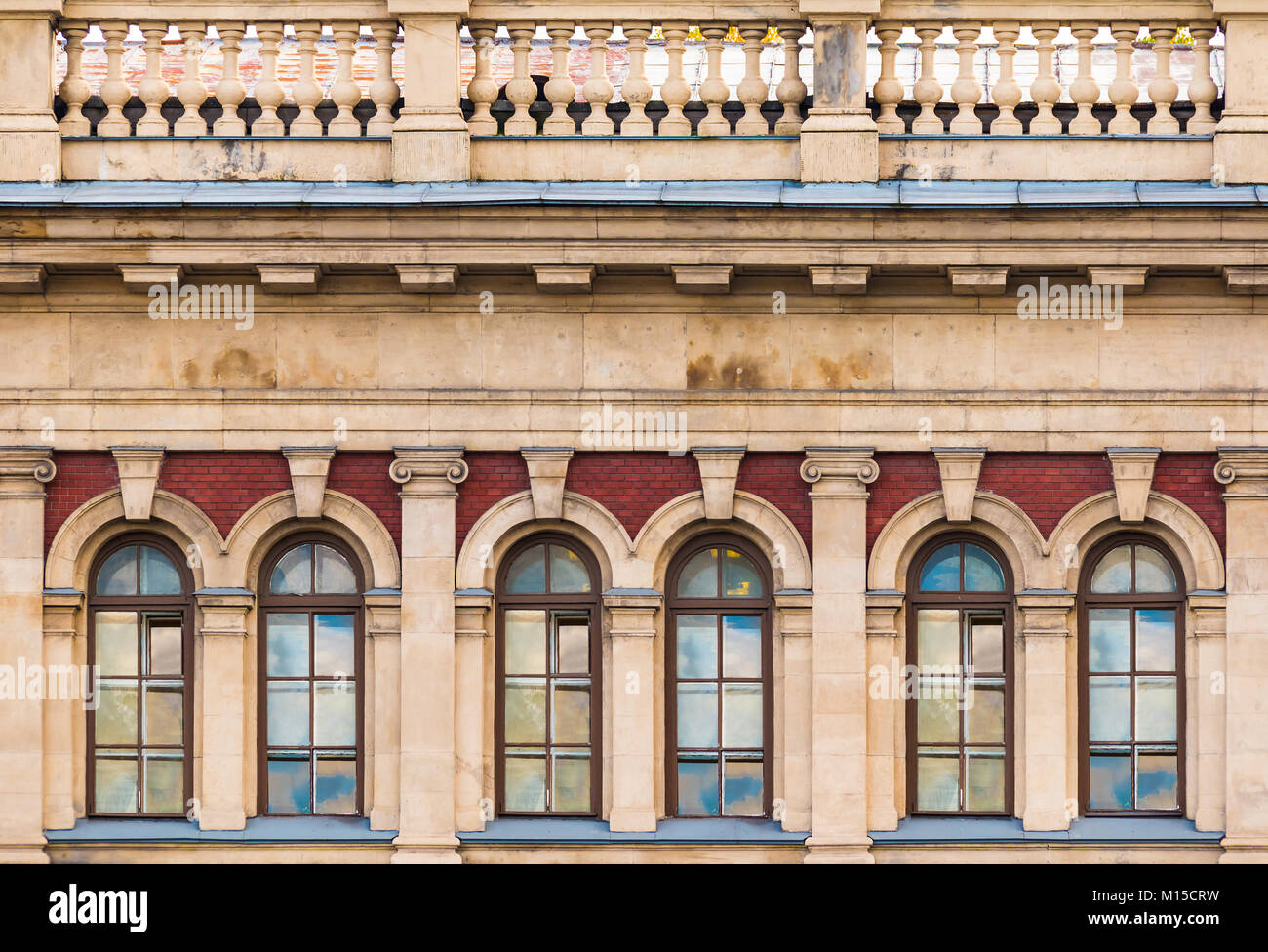 Several windows in a row and balustrade on the facade of the urban historic building front view, Saint Petersburg, - Stock Image