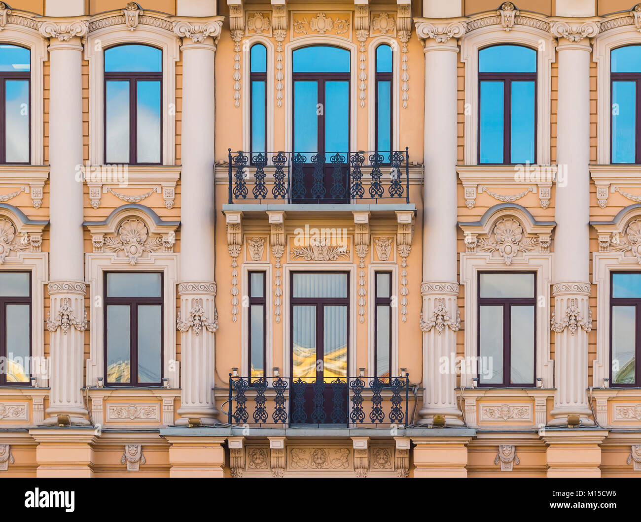 Several windows in a row and balconies on the facade of the urban historic building front view, Saint Petersburg, - Stock Image
